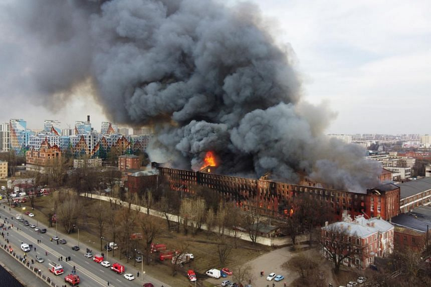 Flames and smoke rise during a fire at the Nevskaya Manufaktura factory in central Saint Petersburg, on April 12, 2021.