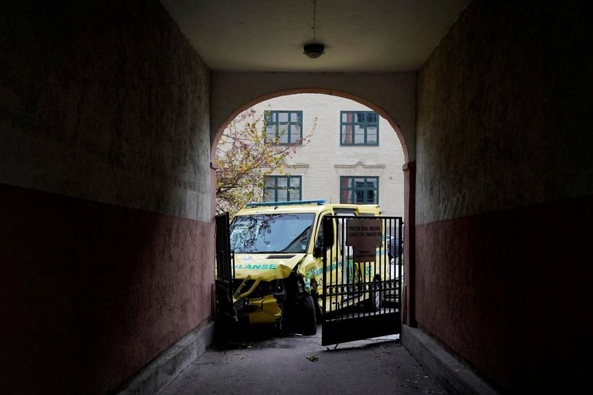 In this photo taken on Oct 22, 2019, a damaged ambulance stands next to a building after an armed man who stole the vehicle was apprehended by police in Oslo.