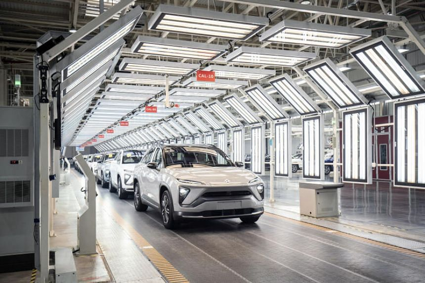 Nio Inc electric vehicles being rolled off the production line during an event at the automaker's factory in Hefei, China, on April 7, 2021.