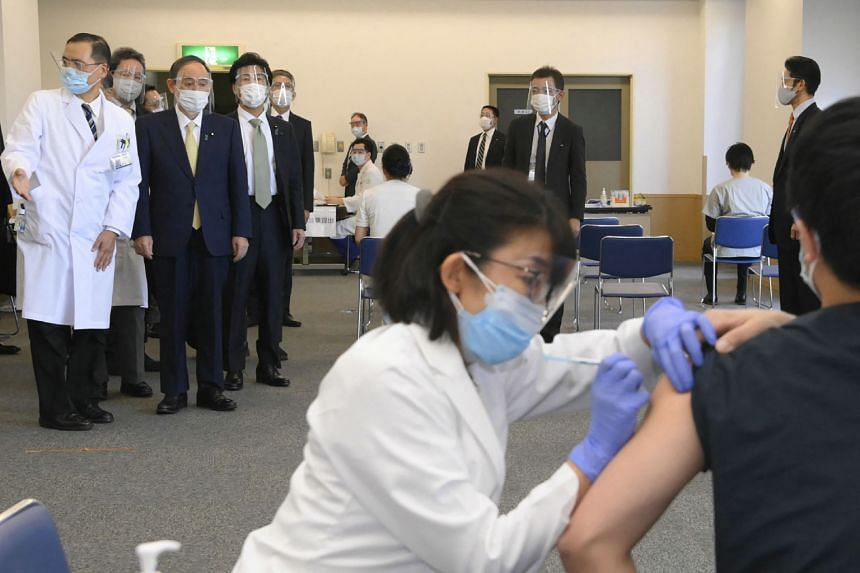 Japan's Prime Minister Yoshihide Suga inspects the vaccination program at the state-run Tokyo Medical Center on Feb 18, 2021.