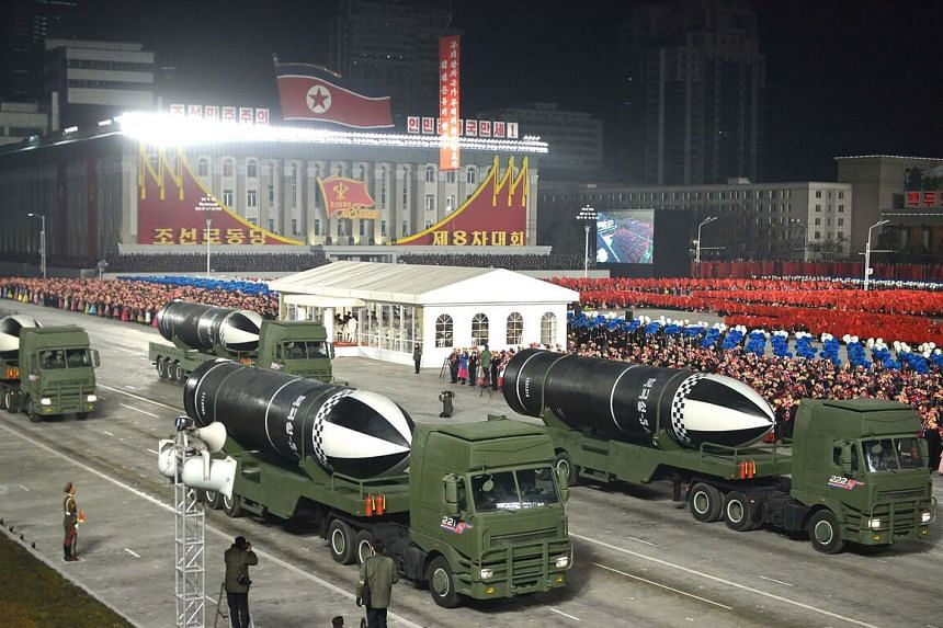 A handout picture showing what appears to be submarine-launched ballistic missiles during a military parade in Pyongyang on Jan 14, 2021.