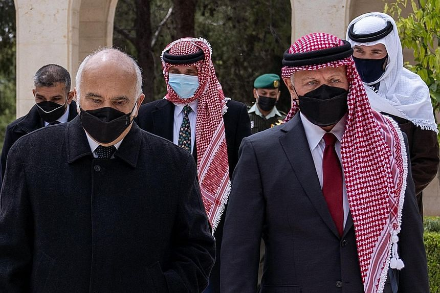 Jordan's King Abdullah (right) and Prince Hamzah (centre, behind) arriving at the Raghadan Palace on Sunday - their first joint public appearance since a crisis involving the prince rocked the kingdom last week. PHOTO: AGENCE FRANCE-PRESSE