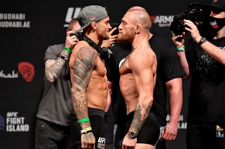 Dustin Poirier (left) and Conor McGregor at Etihad Arena on UFC Fight Island, in Abu Dhabi, on Jan 22, 2021.