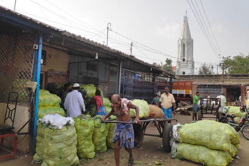 Vegetables getting ready for export in Tiruchirapalli's wholesale vegetable market.
