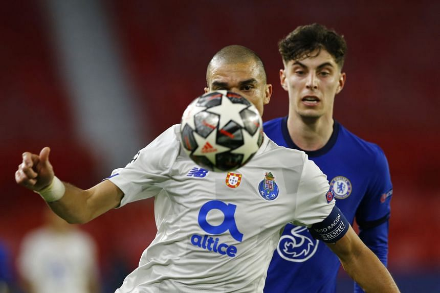 Chelsea's Christian Pulisic in action with FC Porto's Pepe.