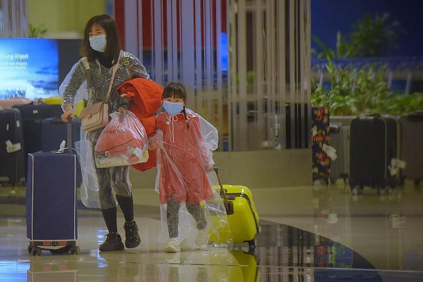 Visitors from China at Changi Airport in February. Some 70 per cent of the total number of travellers who entered Singapore under the air travel pass (ATP) scheme were from China.
