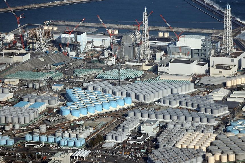 There are more than 1,000 storage tanks, each 10m tall, at the Fukushima Daiichi complex, holding 1.25 million cu m of water. PHOTO: EPA-EFE