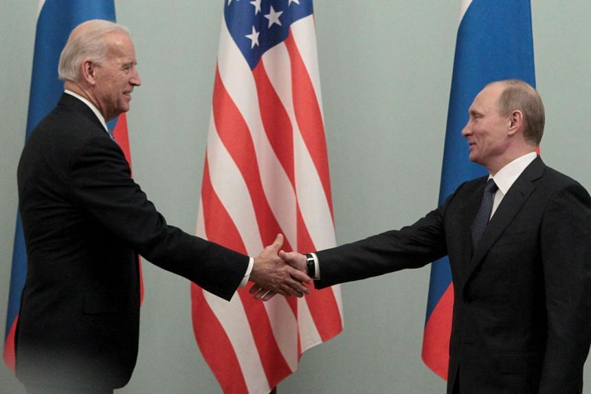 Then US Vice-President Joe Biden (left) and Russian Prime Minister Vladimir Putin meeting in Moscow in this 2011 file photo.
