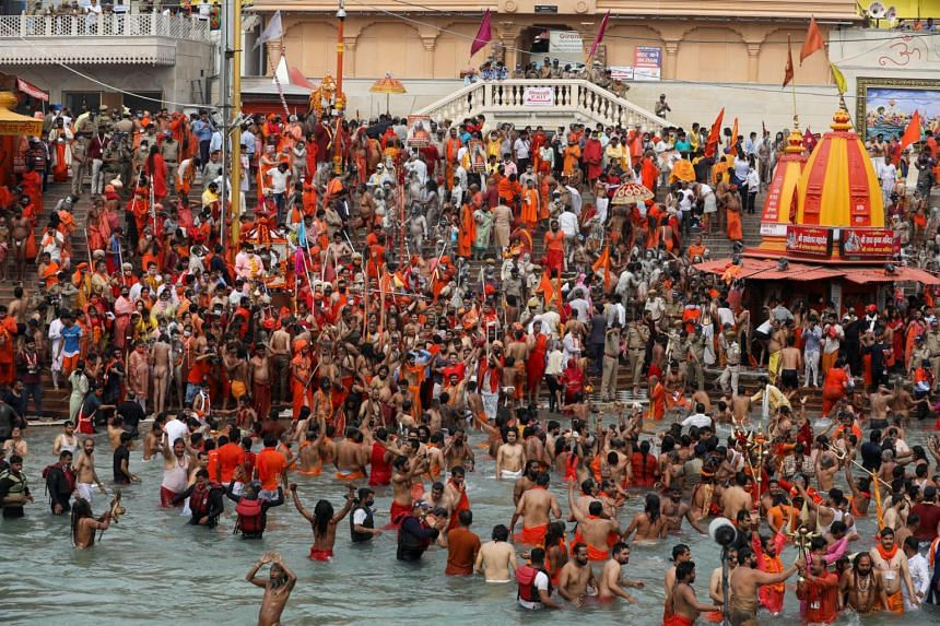 Sadhus, or Hindu holy men, taking a dip in the Ganges amid the Kumbh Mela, or pitcher festival, in Haridwar, India, on April 12.