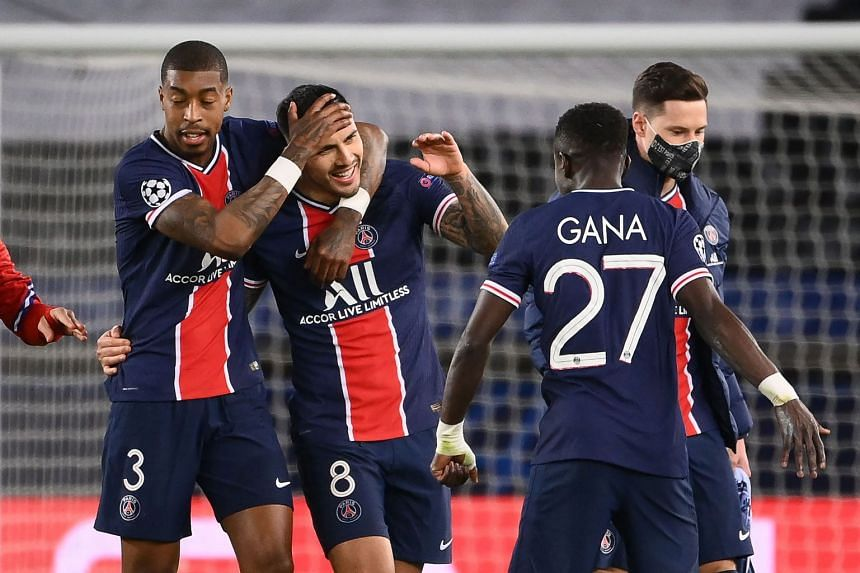 Paris Saint-Germain's Presnel Kimpembe, Leandro Paredes, Idrissa Gueye andJulian Draxler celebrate after the match.