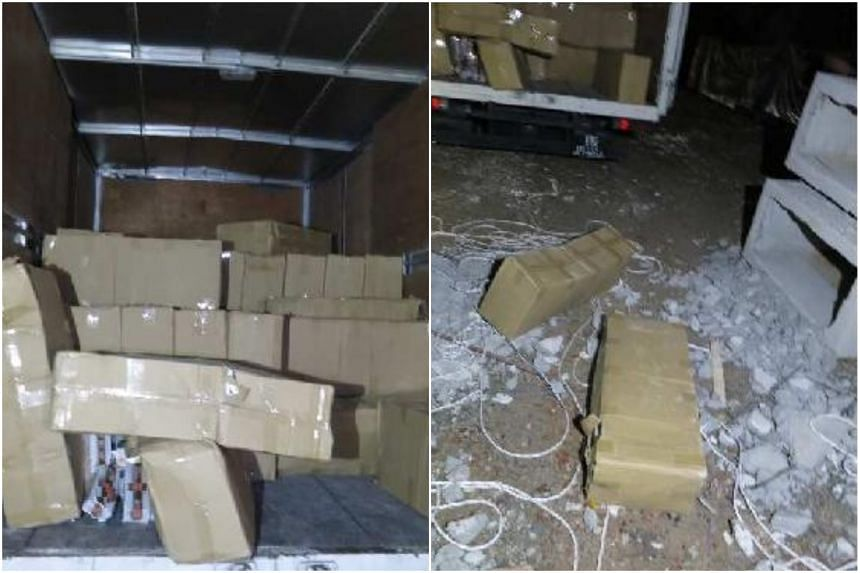 A Singapore-registered truck (left) and concrete slabs containing carton boxes of duty-unpaid cigarettes (right) found at a storage yard in Penjuru Walk.