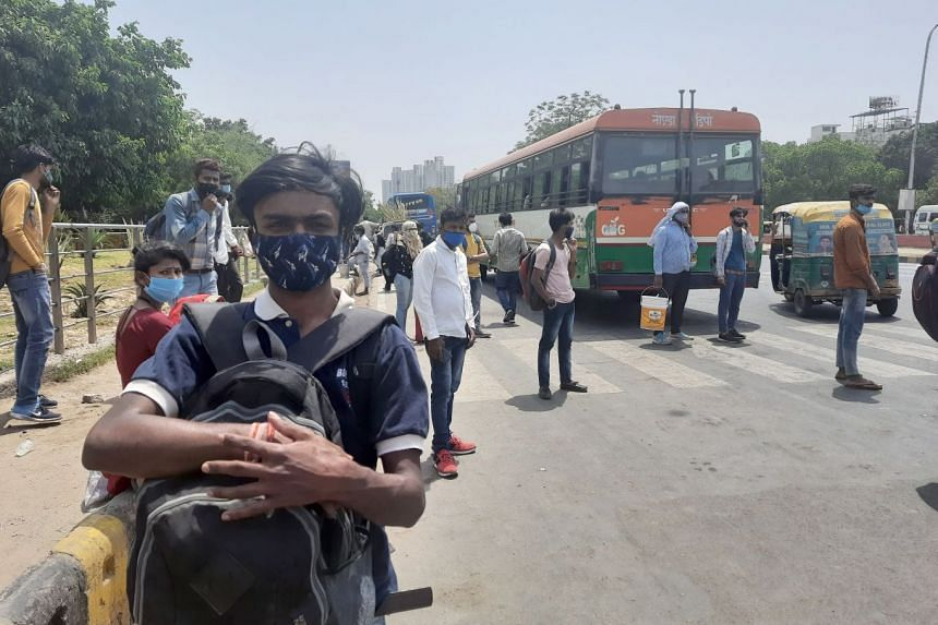 Migrant worker Sachin Chauhan, 21, waiting for a bus to take him back home in Aligarh, Uttar Pradesh.
