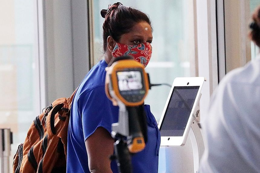 Gayathri Iyer entering the State Courts yesterday. She had been convicted in February of abusing her Myanmar maid, after slapping her so hard that she suffered a temporary loss of hearing.