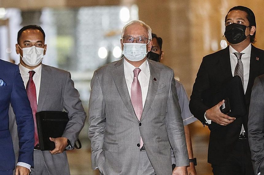 Najib Razak (centre) arriving at the Court of Appeal in Putrajaya yesterday. The Pekan MP remains free, pending his appeal. PHOTO: EPA-EFE