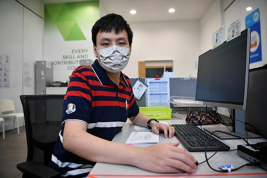 Mr Elliot Goh, who has autism spectrum disorder, was placed in an authentic work setting and learnt to work with the machines required in his role as a digital services assistant at the National Library Board.