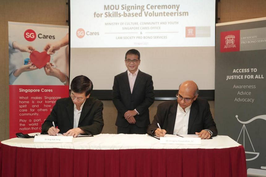 (From left) MCCY deputy secretary Ang Hak Seng, MCCY Minister Edwin Tong and Law Society Pro Bono Services chairman Gregory Vijayendran.