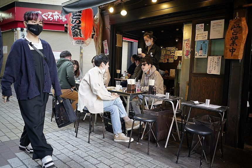 Diners at a restaurant at Ueno district in Tokyo on April 12, 2021.