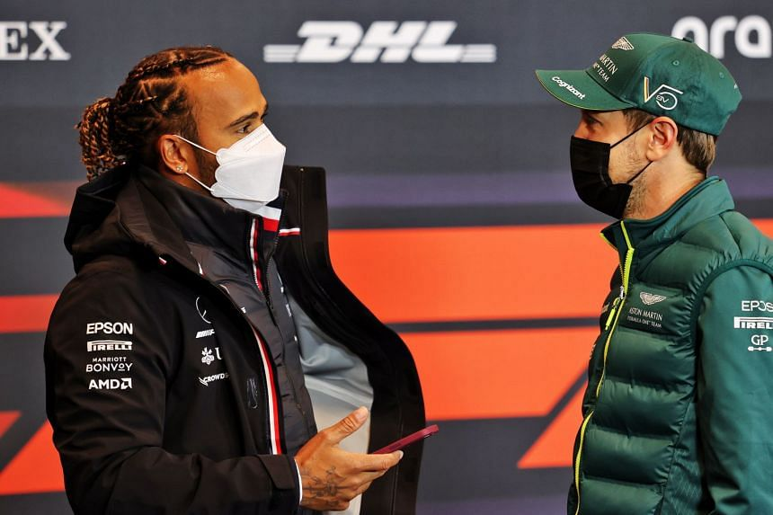Hamilton (left) and Vettel speak at the FIA press conference at the Imola race track in Italy, on April 15, 2021.