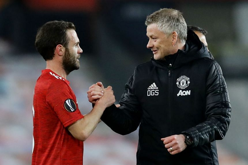 Solskjaer with United's Juan Mata after the team's Europa League match against Granada.