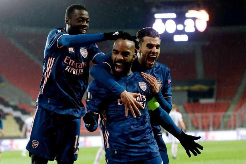 Arsenal's Alexandre Lacazette celebrates scoring their second goal with teammates.