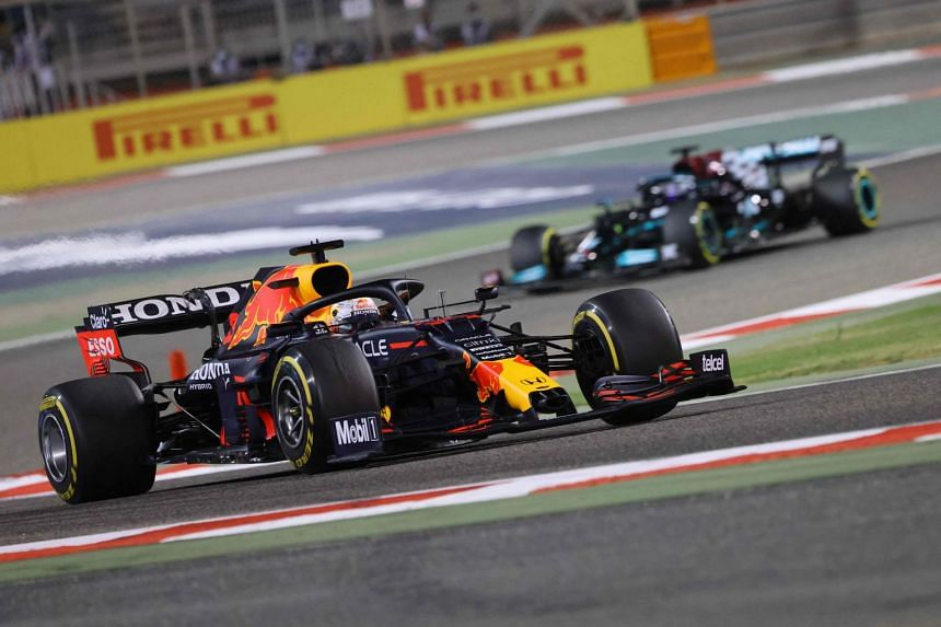 Red Bull's Max Verstappen leads Mercedes' Lewis Hamilton during the Bahrain Formula One Grand Prix on March 28, 2021.