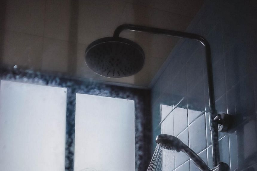 A photo illustration of a shower. The man placed a camera in the toilet, but the woman found it when it dropped as she took a bath.