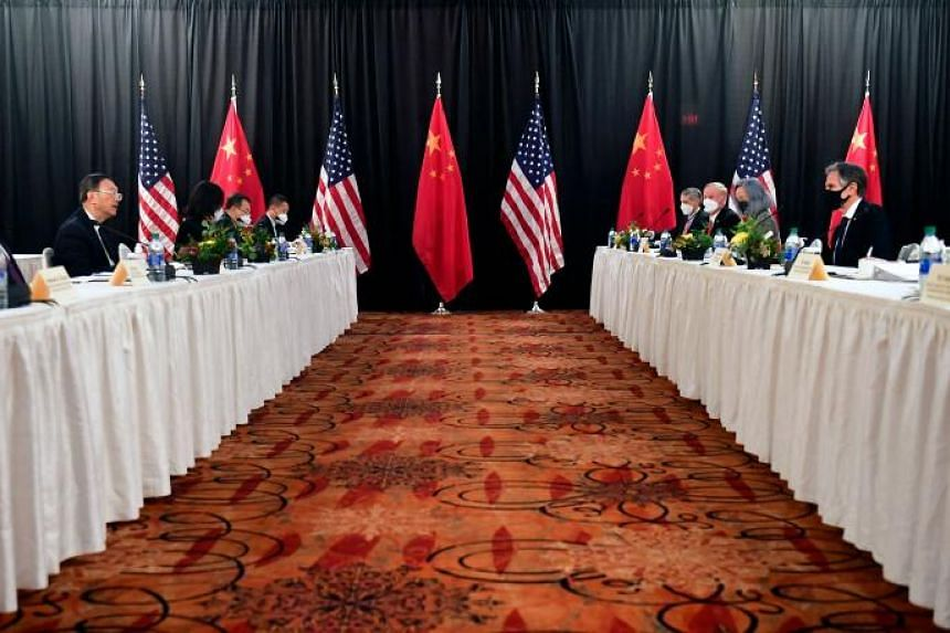 US Secretary of State Antony Blinken (second right) speaks while facing Yang Jiechi (second left), director of the Central Foreign Affairs Commission Office, and Wang Yi (left), China's Foreign Minister at the opening session of US-China talks at the
