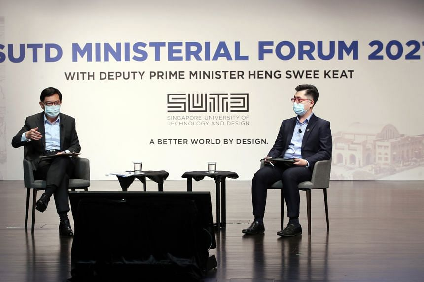DPM Heng Swee Keat participating in a dialogue moderated by final-year SUTD student Ng Jing Da at SUTD on April 16, 2021.