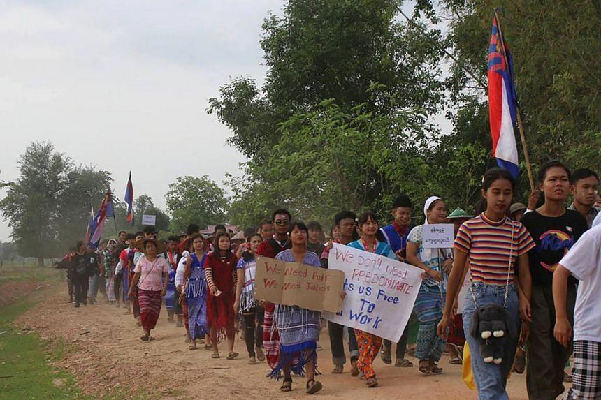 Protesters marching during a general strike demonstration in Kawkareik, in eastern Myanmar's Karen state, on April 14, 2021.