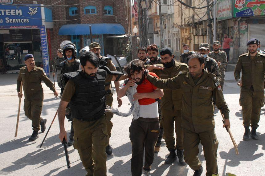 Pakistani security officials arrest supporters of Islamic political party Tehreek-e-Labbaik Pakistan in Rawalpindi, Pakistan, on April 14, 2021.