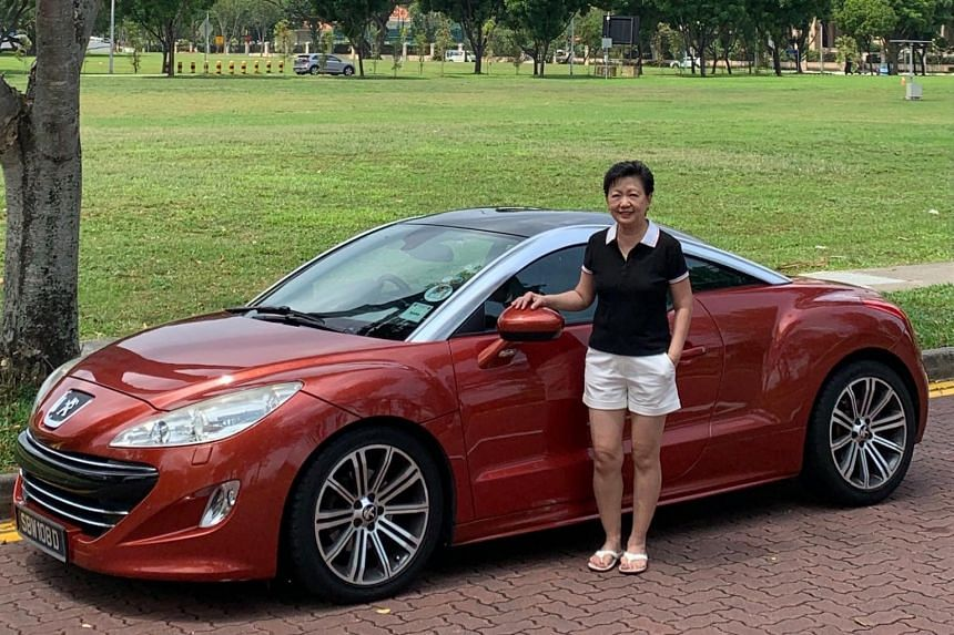 Artist and writer Joanna Wong with her Peugeot RCZ.