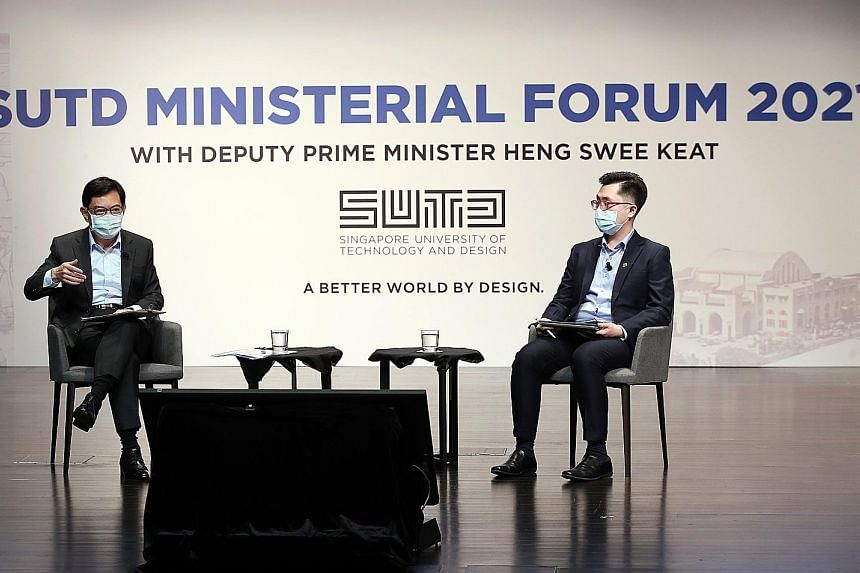 Deputy Prime Minister Heng Swee Keat speaking to students during yesterday's dialogue at the Singapore University of Technology and Design. The dialogue was moderated by final-year student Ng Jin Da (right). In his speech, Mr Heng suggested three new
