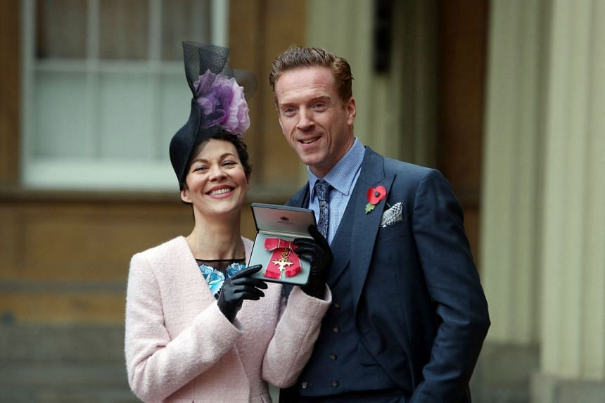A 2017 photo shows actress Helen McCrory posing with husband Damian Lewis after she was awarded a British OBE for services to drama.