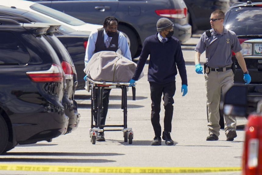 A body is transported from the Fedex facility in Indianapolis on April 16, 2021 following the overnight shooting.