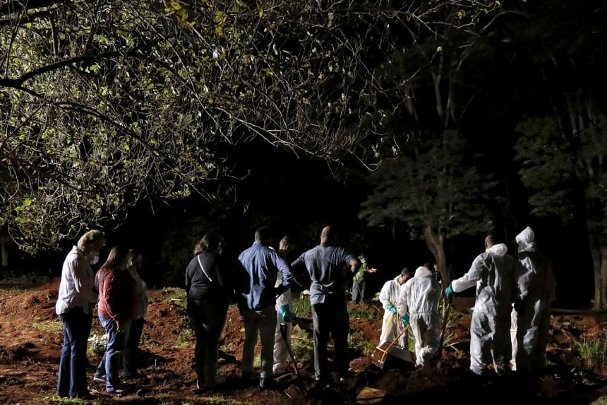 A night burial at Vila Formosa cemetery in Sao Paulo, Brazil, on March 31, 2021.