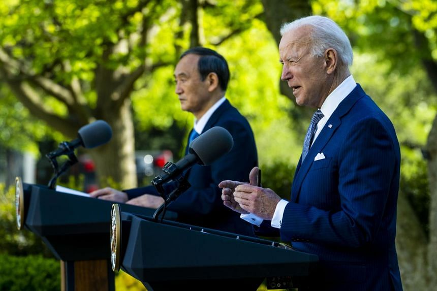 US President Joe Biden and Japan's Prime Minister Yoshihide Suga in a joint press conference in the Rose Garden of the White House on April 16, 2021.