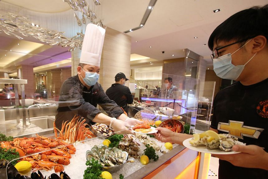 Staff-served buffet line at Carousel's Signature Seafood Counter.