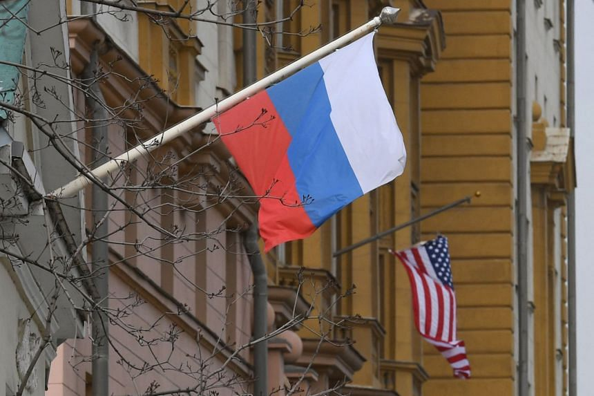 A Russian flag flies next to the US embassy building in Moscow on April 15, 2021.