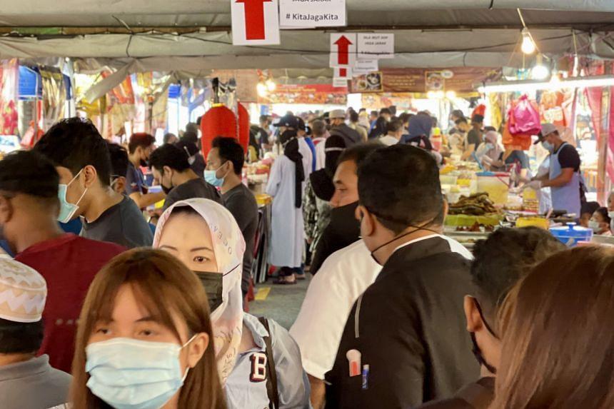 Visitors at the Kampung Pandan bazaar in Kuala Lumpur on April 17, 2021.