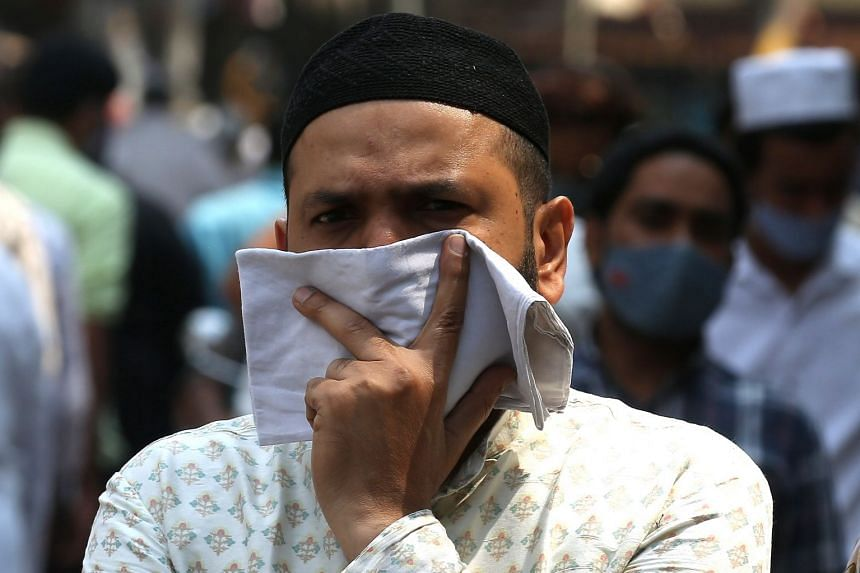 An Indian Muslim man covers his face with a piece of cloth in Bangalore, India, April 16, 2021.