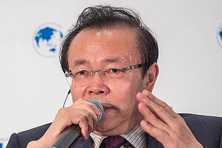 China Huarong Asset Management was once lorded over by Lai Xiaomin (above) until he was ensnared in a sweeping crackdown on corruption by Beijing. He was executed in January. PHOTOS: BLOOMBERG, AGENCE FRANCE-PRESSE