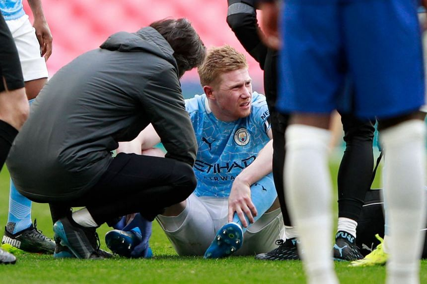 Manchester City's Belgian midfielder Kevin De Bruyne receives medical attention after picking up an injury against Chelsea.