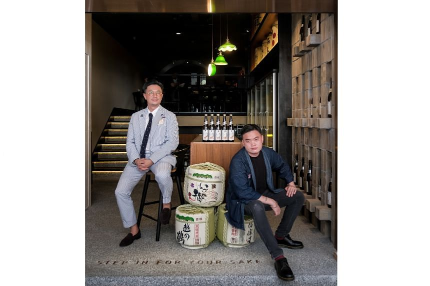 (Above from left) Mr Raymond Lim, director of Sake Labo, and sommelier Reuben Oh at the Japanese tapas bar in Stanley Street. It is one of several venues focused on sake that have popped up in the last six months.