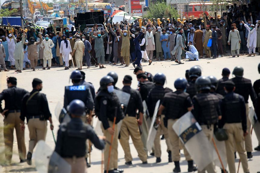 Police clash with supporters of Islamic political party Tehreek-e-Labbaik Pakistan, in Peshawar, Pakistan, on April 13, 2021.