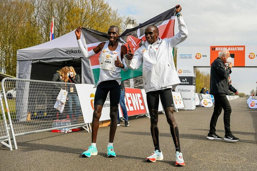 Kenya's Jonathan Korir and Olympic champion Eliud Kipchoge celebrating after finishing second and first respectively at the NN Mission Marathon in Enschede. The race was a qualifier for the Tokyo Games.