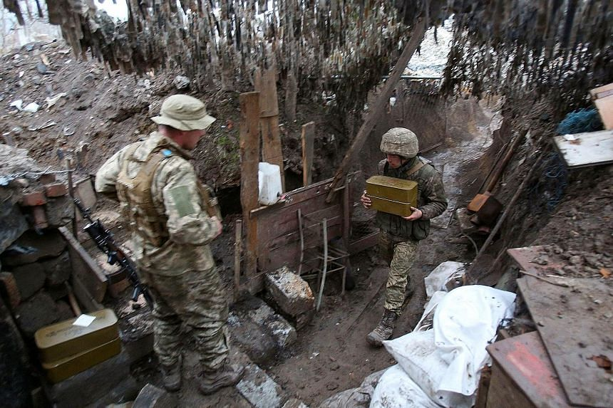 Ukrainian troops on duty on the eastern front line where the country has been fighting Russian-backed separatists since 2014. Russia has also been massing its troops recently on Ukraine's eastern flank.