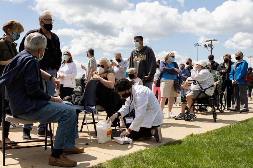 People waiting to receive the Covid-19 vaccine at a clinic as cases rise in the state in Lansdale, Pennsylvania, on April 18, 2021.