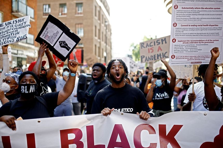 Demonstrators take part in a Black Lives Matter protest in London, on July 12, 2020.