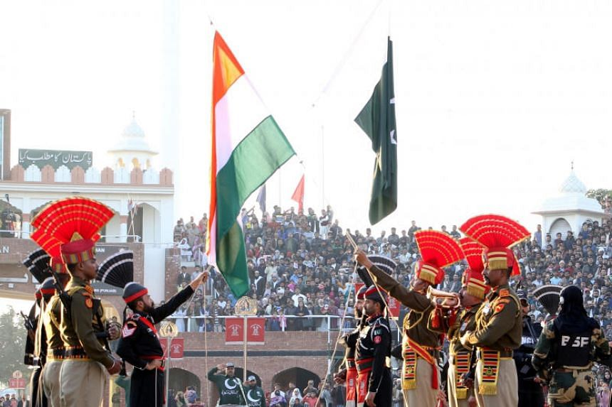 Border Security Force personnel and Pakistani Rangers personnel during the Beating Retreat ceremony at 71st Republic Day celebrations at the India-Pakistan border post at Attari, Amritsar on Jan 26, 2020.