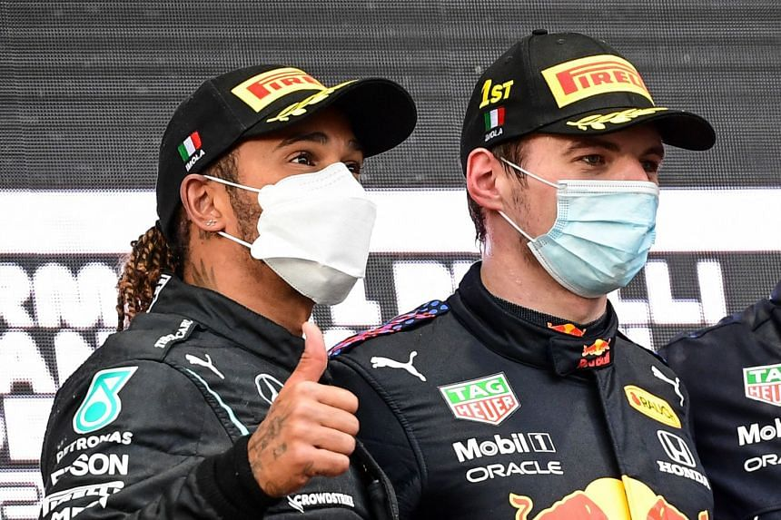 Red Bull's Max Verstappen (right) and Mercedes' Lewis Hamilton on the podium after the Emilia Romagna Formula One Grand Prix on April 18, 2021.